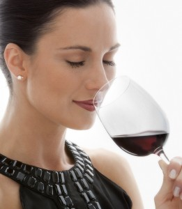Attractive woman drinking wine.